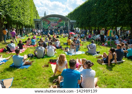 """MOSCOW - JUNE 15: People attend open-air concert on X International Jazz Festival """"Usadba Jazz"""" in Archangelskoye Museum-Mansion on June 15, 2013 in Moscow - stock photo"""
