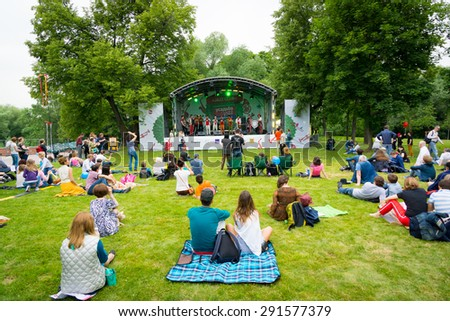 "MOSCOW - JUNE 20, 2015: People attend open-air concert on XII International Jazz Festival ""Usadba Jazz"" in Tsaritsyno Park on June 20, 2015 in Moscow - stock photo"