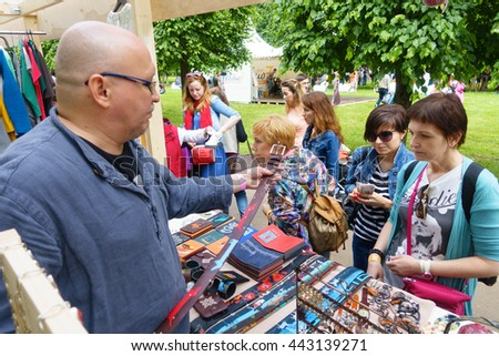 "MOSCOW - JUNE 4: People buying souvenirs on International Jazz Festival ""Usadba Jazz"" in Archangelskoye Museum-Mansion on June 4, 2016 in Moscow - stock photo"