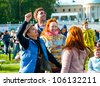 "MOSCOW - JUNE 3: People cheer and attend open-air concert on IX International Jazz Festival ""Usadba Jazz"" in ""Archangelskoye Mansion"" on June 3, 2012 in Moscow, Russia. - stock photo"