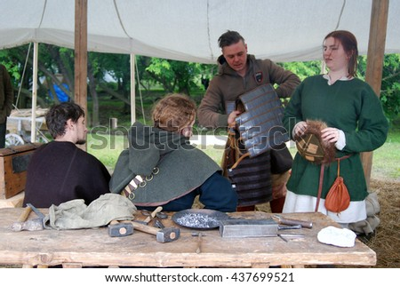 MOSCOW - JUNE 12, 2016: Reenactors show their skills in Kolomenskoye recreation park and manor in Moscow. Popular landmark.
