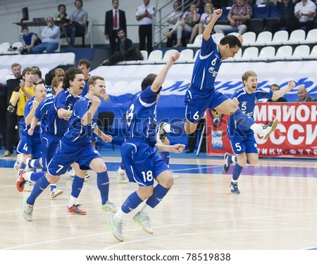 MOSCOW - JUNE 2, Russian Futsal championship, play-off games Dinamo vs. Sinara, final on June 2, 2011 in Moscow. Dinamo is celebrating the second win in series. Tatu is jumping high. - stock photo