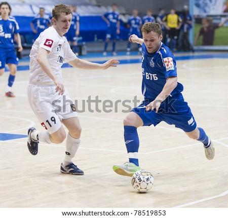 MOSCOW - JUNE 2, Russian Futsal championship, play-off games Dinamo vs. Sinara, final on June 2, 2011. Fukin (Dinamo) is trying to kick a goal - stock photo