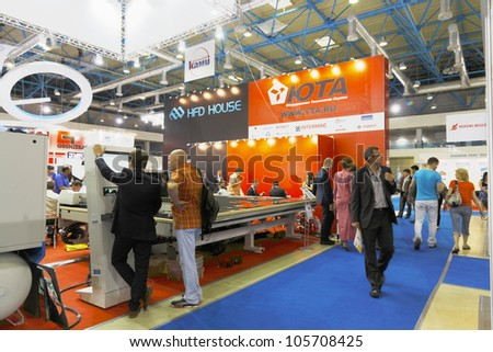 MOSCOW-JUNE 15:The stand Russian company YTA to supply equipment for cutting and processing glass from Europe and China at the International Exhibition MIR STEKLA'2012 on June 15, 2012 in Moscow - stock photo