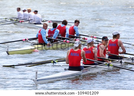 MOSCOW  - JUNE 5: Three boats with four men teams rowing at Great Moscow Regatta 2011 on June 5, 2011 in Moscow, Russia.