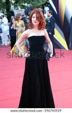 MOSCOW - JUNE 20, 2013: Tv presenter Anna Chapman at XXXV Moscow International Film Festival red carpet opening ceremony.  - stock photo