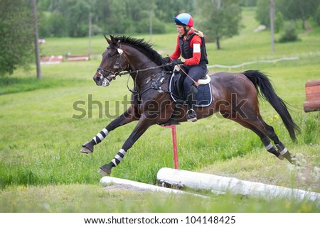 MOSCOW - JUNE 02: Unidentified rider on horse overcomes the obstacle at the International Eventing Competition CCI3*/2*/1* Russian Cup Eventing June 02, 2012 in Moscow, Russia