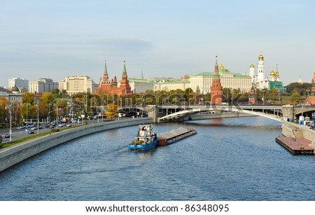 Moscow Kremlin and barge on river Moskva in a sunny day