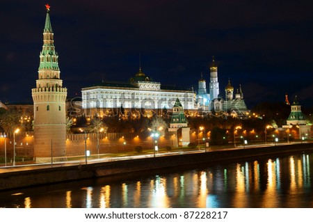 Moscow Kremlin and river under night sky