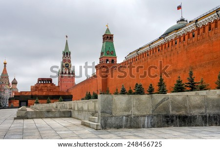 Moscow Kremlin and Spasskaya Tower in summer cloudy day - stock photo