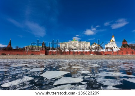 Moscow Kremlin during an ice drift across the Moskva River - stock photo