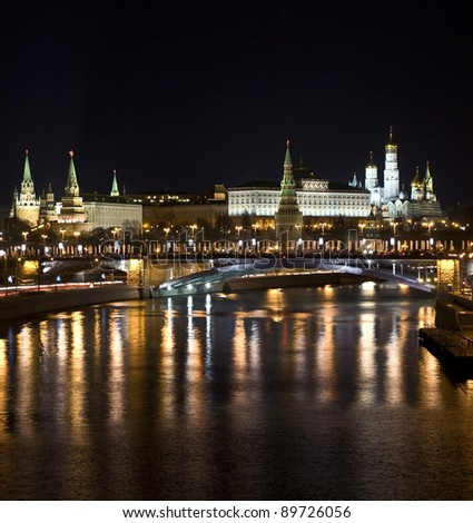 Moscow, Kremlin fortress with palace and cathedrals inside on bank of Moscow-river at night.
