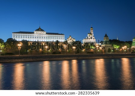 Moscow Kremlin in the evening lights, reflecting in the Moscow river - stock photo