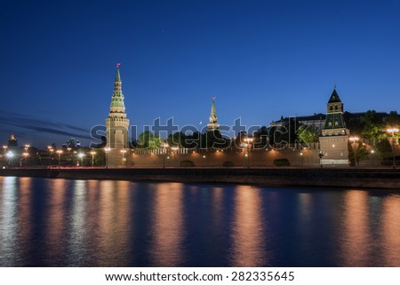 Moscow Kremlin in the evening lights, reflecting in the Moscow river
