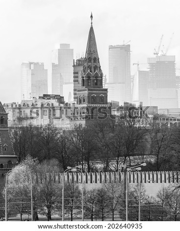 Moscow Kremlin on the modern building background, Russian Federation (black and white) - stock photo