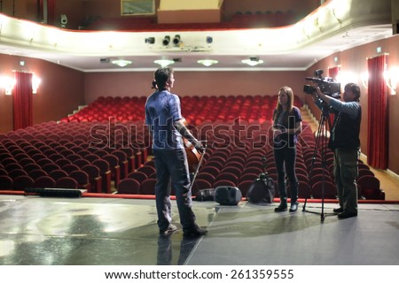 MOSCOW - MAR 12, 2014: Interview with actor of Taper-show on stage of the Palace on Yauza - stock photo