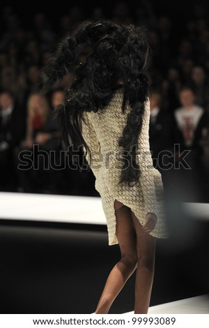 MOSCOW - MARCH 25: A Model walks runway at the Dima Neu for Fall/Winter 2012 presentation during MBFW on March 25, 2012 in Moscow, Russia