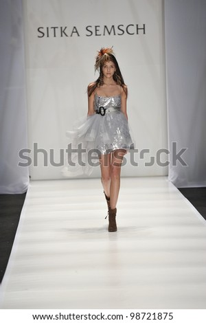 MOSCOW - MARCH 24: A Model walks runway at the Sitka Semsch for Fall Winter 2012 presentation during MBFW on March 24, 2012 in Moscow, Russia - stock photo