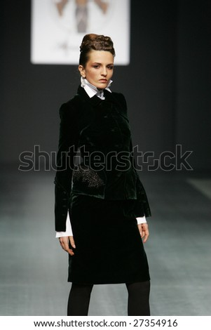 MOSCOW - MARCH 25: A model walks the runway during the Alina Assi Collection as part of Fashion Week, March 25, 2009 in Moscow, Russia.