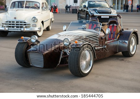 """MOSCOW - MARCH 28: Caterham ALEX retro car on display near the Concert Hall """"Russia"""" before the tournament promotion FIGHT NIGHTS - """"Battle 15: Revenge"""" on September 28, 2014. Moscow, Russia, Luzhniki - stock photo"""