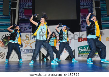 MOSCOW - MARCH 27 : members break dance team SM - Super Girls on stage during contest Hip Hop International - Cup Of Russia March 27, 2010 in Moscow, Russia. These girls took first place in Adults cat - stock photo