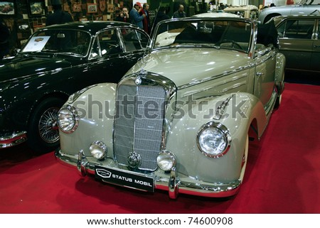 MOSCOW - MARCH 25: Mercedes - Benz 220 Cabriolet on display at at the Moscow Exhibition of technical antiques on March 25, 2011 in Moscow, Russia. - stock photo
