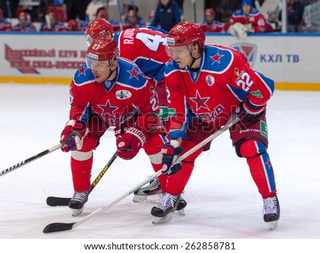 MOSCOW - MARCH 12: N. Zaytsev (22) and I. Grigorenko (27) on faceoff during hockey game Yokerit vs CSKA on Russia KHL championship on March 12, 2015, in Moscow, Russia. CSKA won 3:2 - stock photo