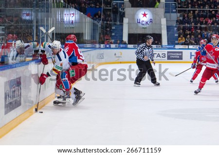 MOSCOW - MARCH 12: O. Vaanaanen (4) fights with A. Kuzmenko (96) on hockey game Yokerit vs CSKA on Russia KHL championship on March 12, 2015, in Moscow, Russia. CSKA won 3:2 - stock photo