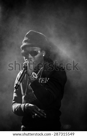 MOSCOW - 27 MARCH, 2015 : Soulja Boy and Migos (Quavo, Takeoff, Offset) performing live in Russia at Space Moscow nightclub - stock photo