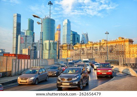 Moscow - march 20: Traffic jam at the entrance to Kutuzov Avenue. Business Center Moscow City. Modern and historic architecture of Moscow . Russia, Moscow, march 20, 2015 - stock photo