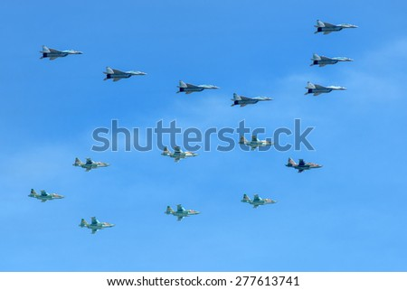 MOSCOW - MAY 9: Airplanes draw number 70 - the MiG-29 and Su-25 Military parade of 70th anniversaries of a victory devoted to celebrating in WWII, on May 9, 2015 in Moscow.