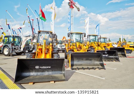MOSCOW - MAY 29: All-purpose wheel loaders of AMKODOR at 13th International Specialized Exhibition CET 2012 at the international exhibition center Crocus Expo, May 29, 2012, Moscow, Russia. - stock photo