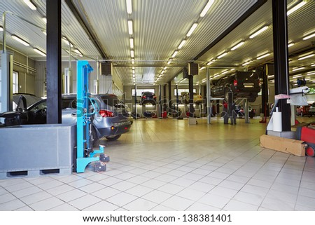 MOSCOW - MAY 30: Cars in workshop of service station Union Motors, May 30, 2012, Moscow, Russia. Union Motors is a specialized center in repairing Nissan cars. - stock photo