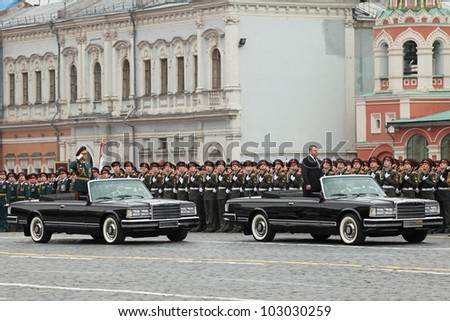 MOSCOW - MAY 09: Celebration of the 67 anniversary of the Victory Day on Red Square on May 9, 2012 in Moscow, Russia. Colonel-general Gerasimov reports to the minister of defense of Russia Serdyukov - stock photo