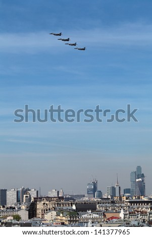 MOSCOW - MAY 09: Celebration of the 68th anniversary of the Victory Day (WWII). Flight of aircraft over the city, a group jet fighter aircraft Mikoyan MiG-29 on May 9, 2013 in Moscow, Russia