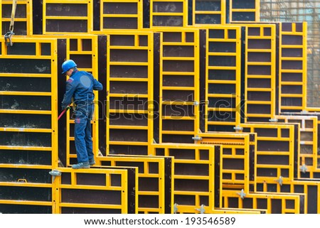 MOSCOW - MAY 6: Construction site worker on may 6, 2014 in Moscow, Russia. Urban construction is at a faster pace in Russia. - stock photo