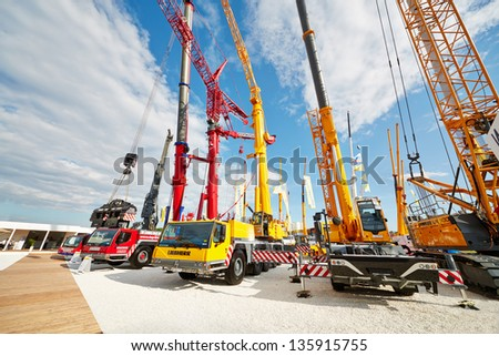 MOSCOW - MAY 29: Cranetrucks and caterpillar cranes at 13th International Specialized Exhibition CET 2012 at the international exhibition center Crocus Expo, May 29, 2012, Moscow, Russia. - stock photo