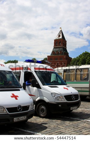 MOSCOW - MAY 29:Emergency ambulances stand by at Avon Walk for Breast Cancer at Red Square on MAY 29, 2010 in Moscow, Russia - stock photo