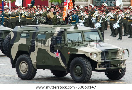 """MOSCOW - MAY 6: GAZ-233014 """"Tiger"""". Dress rehearsal of Military Parade on 65th anniversary of Victory in Great Patriotic War on May 6, 2010 on Red Square in Moscow, Russia - stock photo"""