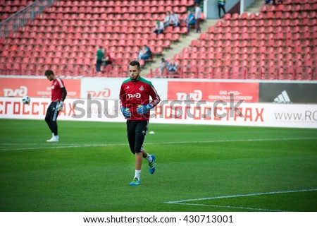 MOSCOW - MAY 11, 2016: Goalkeeper Guilherme Alvim Marinato before soccer game Russian Premier League Lokomotiv (Moscow) vs Kuban (Krasnodar), the stadium Lokomotiv Moscow, Russia. Lokomotiv lost 0: 1 - stock photo