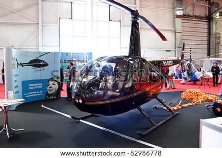 MOSCOW - MAY 19: Helicopter. Robinson R44 Raven2 at the international exhibition of  the helicopter industry, HeliRussia on May 19, 2011 in Moscow