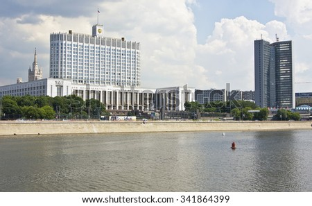 "MOSCOW - MAY 23 2010: House of Russian Government (Russian White house), built in 1979, and building of Moscow Government, known as ""house-book"", built in 1963-1970, on Krasnopresnenskaya quay - stock photo"