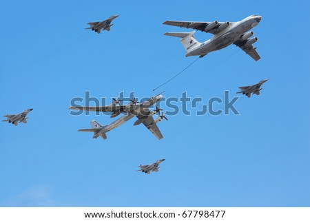 MOSCOW - MAY 9: Il-76 and Tu-95ms planes accompanied by group of fighters Mig-29 on parade in honor of Great Patriotic War victory on May 9, 2010 in Moscow, Russia.