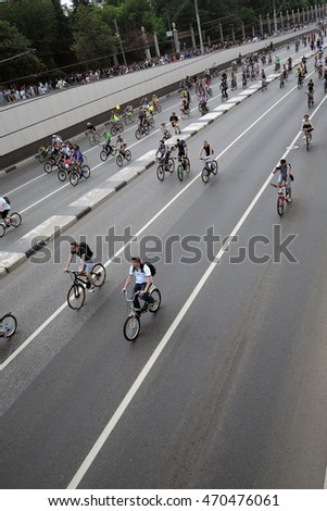 MOSCOW - MAY 29, 2016: Many people ride bikes in Moscow city, on Sadovoye koltso (Garden ring). They participate in a free public bicycle race (parade).