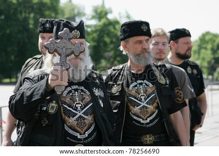 MOSCOW - MAY 28:  Members of a Russian ultra-orthodox clerical group take part in a rally against gay pride parade on May 28, 2011 in Moscow, Russia. - stock photo
