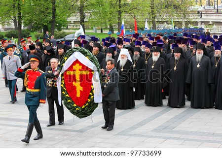 MOSCOW - MAY 8: Metropolitan Juvenaly, priests and big wreath at ceremony of wreath laying at tomb of Unknown Soldier at Victory Day celebrations, on May 8, 2011, Moscow, Russia.
