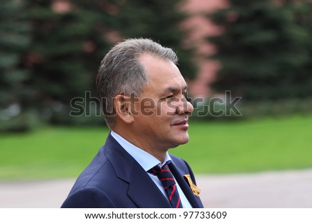 MOSCOW - MAY 8: Minister Sergey Shoigu at ceremony of wreath laying at tomb of Unknown Soldier at Victory Day, on May 8, 2011, Moscow, Russia. - stock photo