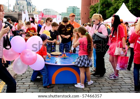 MOSCOW - MAY 29: Participants and unknown children celebrate after the final ceremony speeches at Avon Walk for Breast Cancer at Red Square on MAY 29, 2010 in Moscow, Russia - stock photo