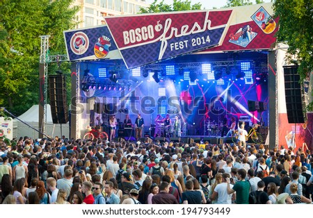 MOSCOW - MAY 24: People attend open-air concert on Bosco Fresh Festival in Muzeon Park on May 24, 2014 in Moscow - stock photo