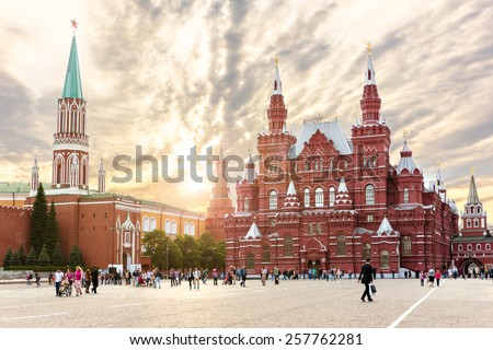 MOSCOW - MAY 16: People walking on the Red Square near Historical museum on May 16, 2014 in Moscow, The State Historical Museum of Russia  wedged between Red Square and Manege Square in Moscow. - stock photo
